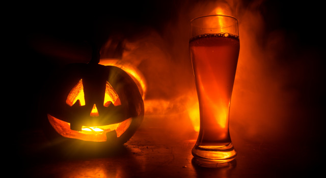 A jack-o-lantern and a beer